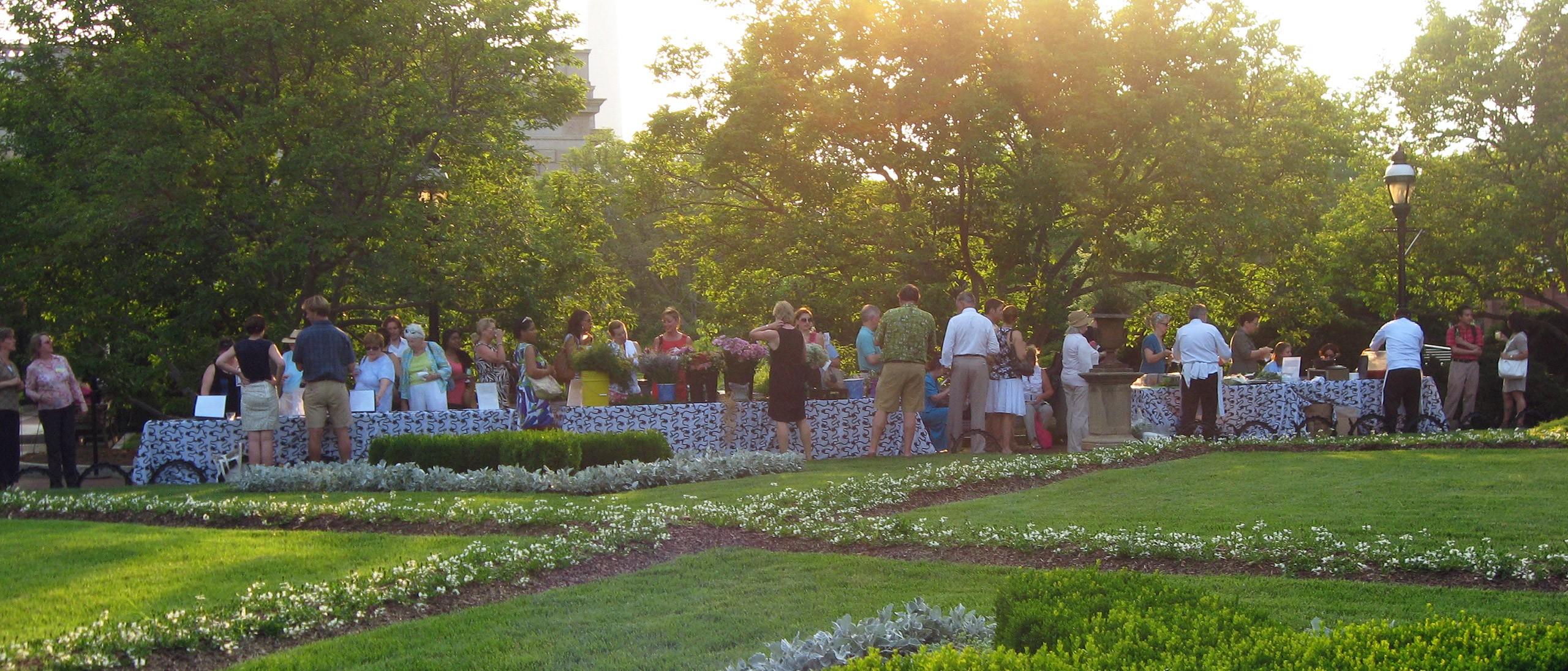 Guests enjoy activities & cocktails in the Enid A. Haupt Garden