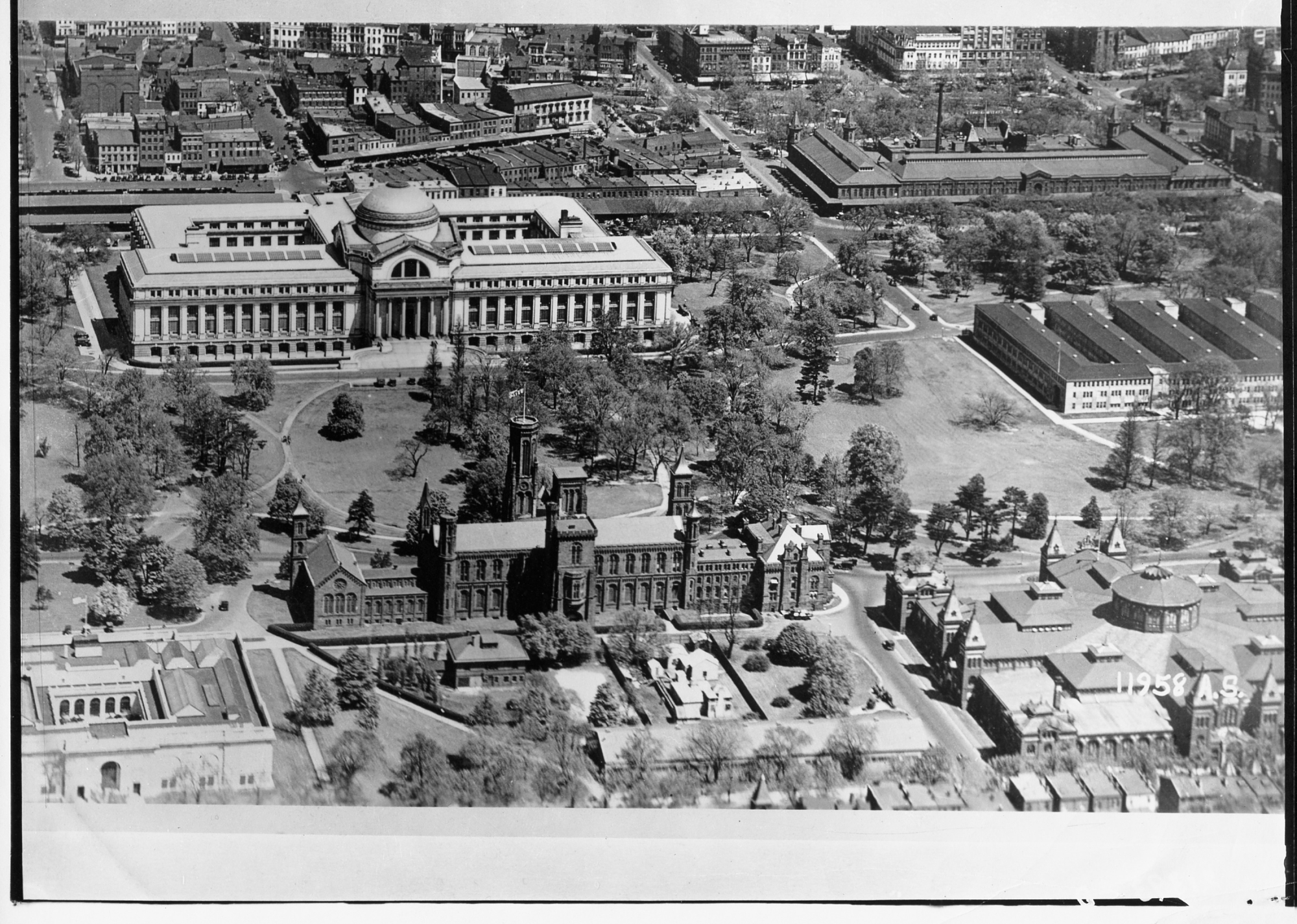 Aerial view of the Smithsonian Institution Building and Natural History building, 1932.