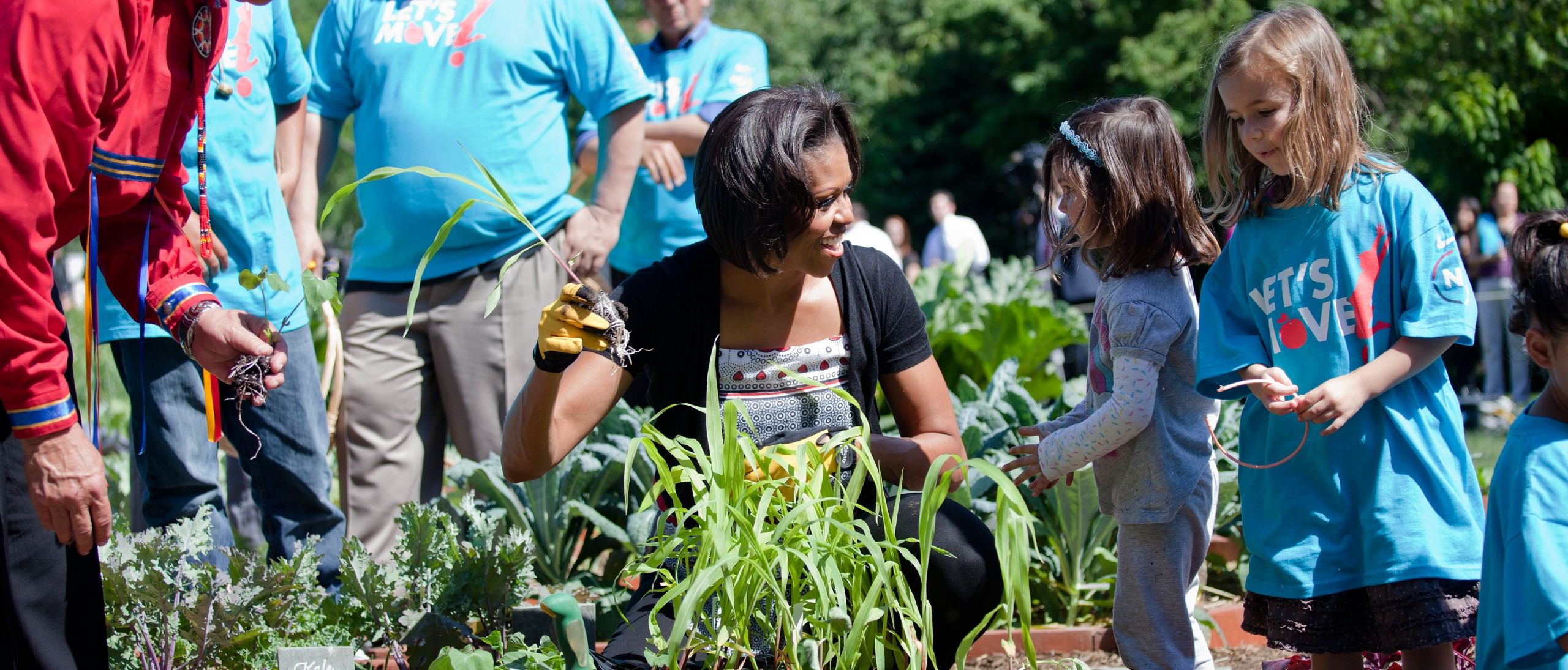 First Lady Michelle Obama and American Indian children plant traditional crops in the White House Kitchen Garden on the South Lawn of the White House, June 3, 2011.