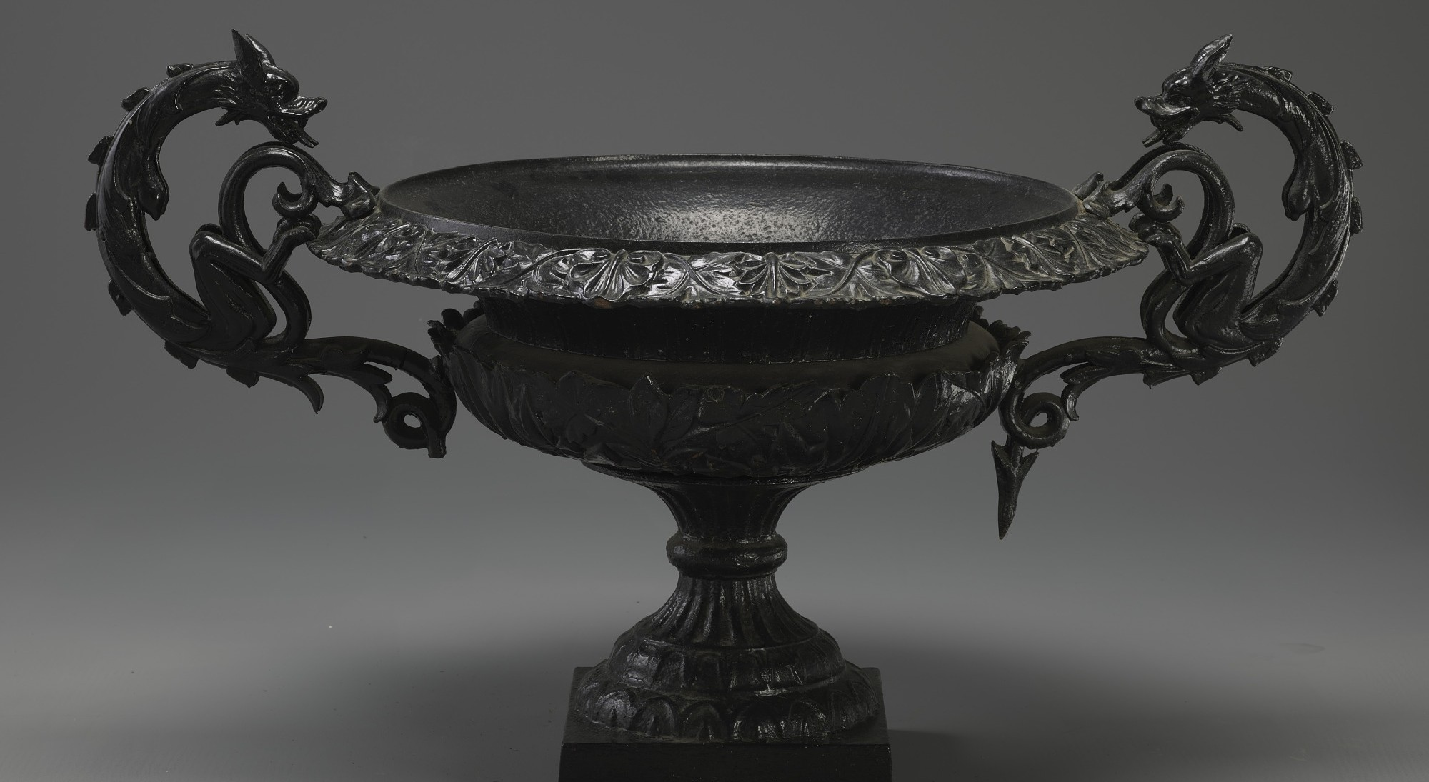 Cast iron urn with dragon detail