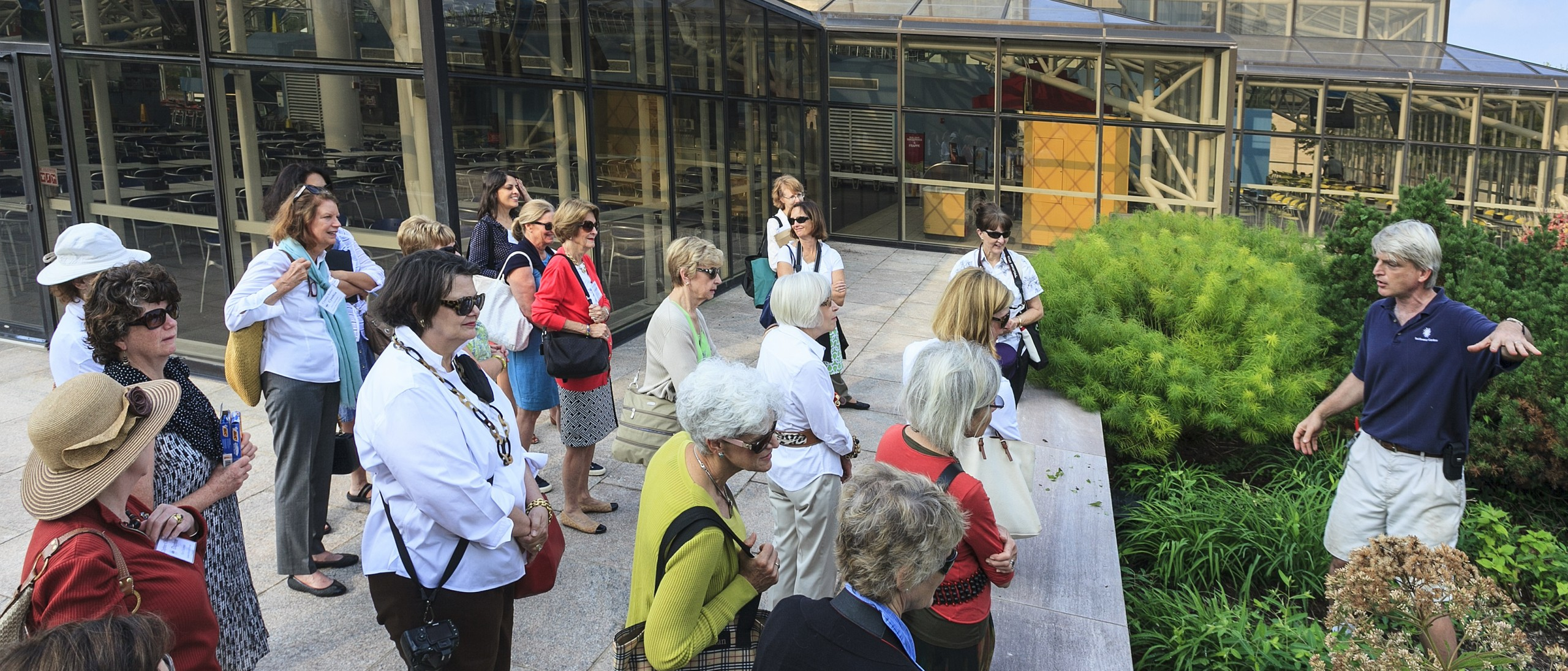 Tour group looking at Air and Space Landscape plantings