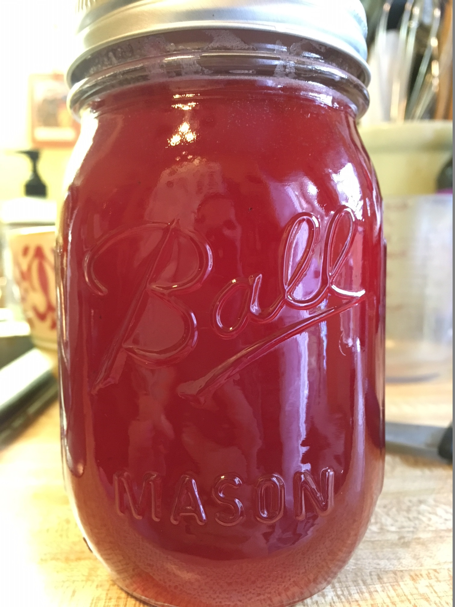 Mason jar of red beautyberry jelly