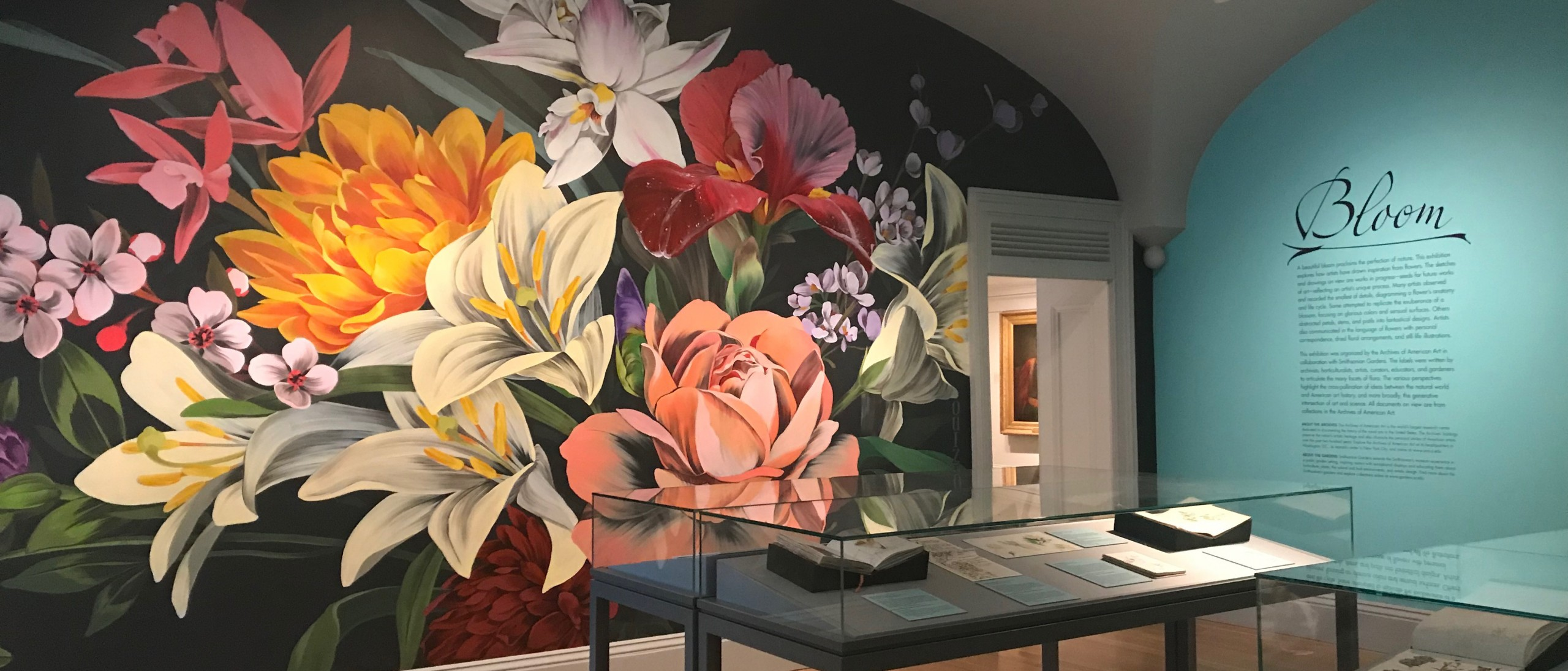 Painted mural of multicolored flowers in exhibit room