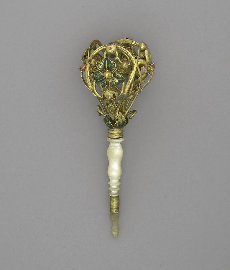 Bouquet holder, flower and scrolls, mother of pearl handle