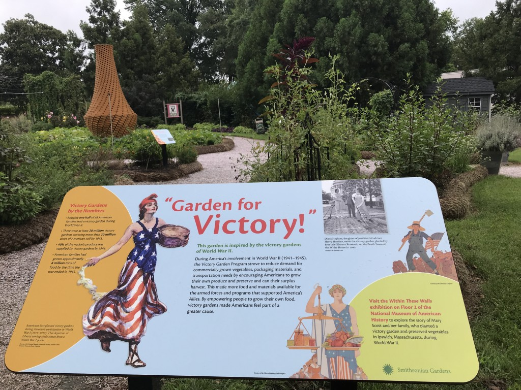 """Garden interpretive panel """"Gardening for Victory!"""" ls located in the Victory Garden at the National Museum of American History."""