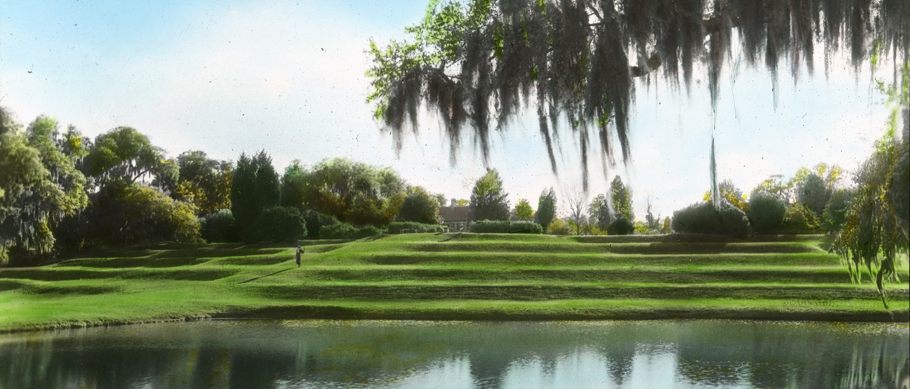 Terraced lawn by a pond